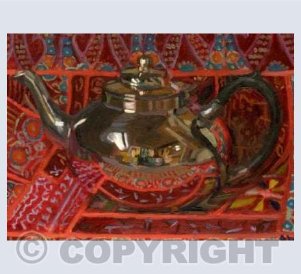 Silver teapot on Indian Cloth