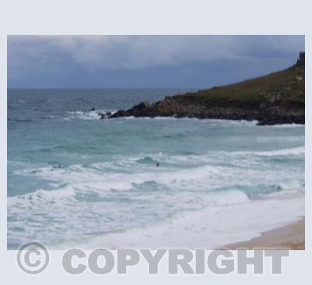 Surfing the storm waves at Porthmeor St Ives